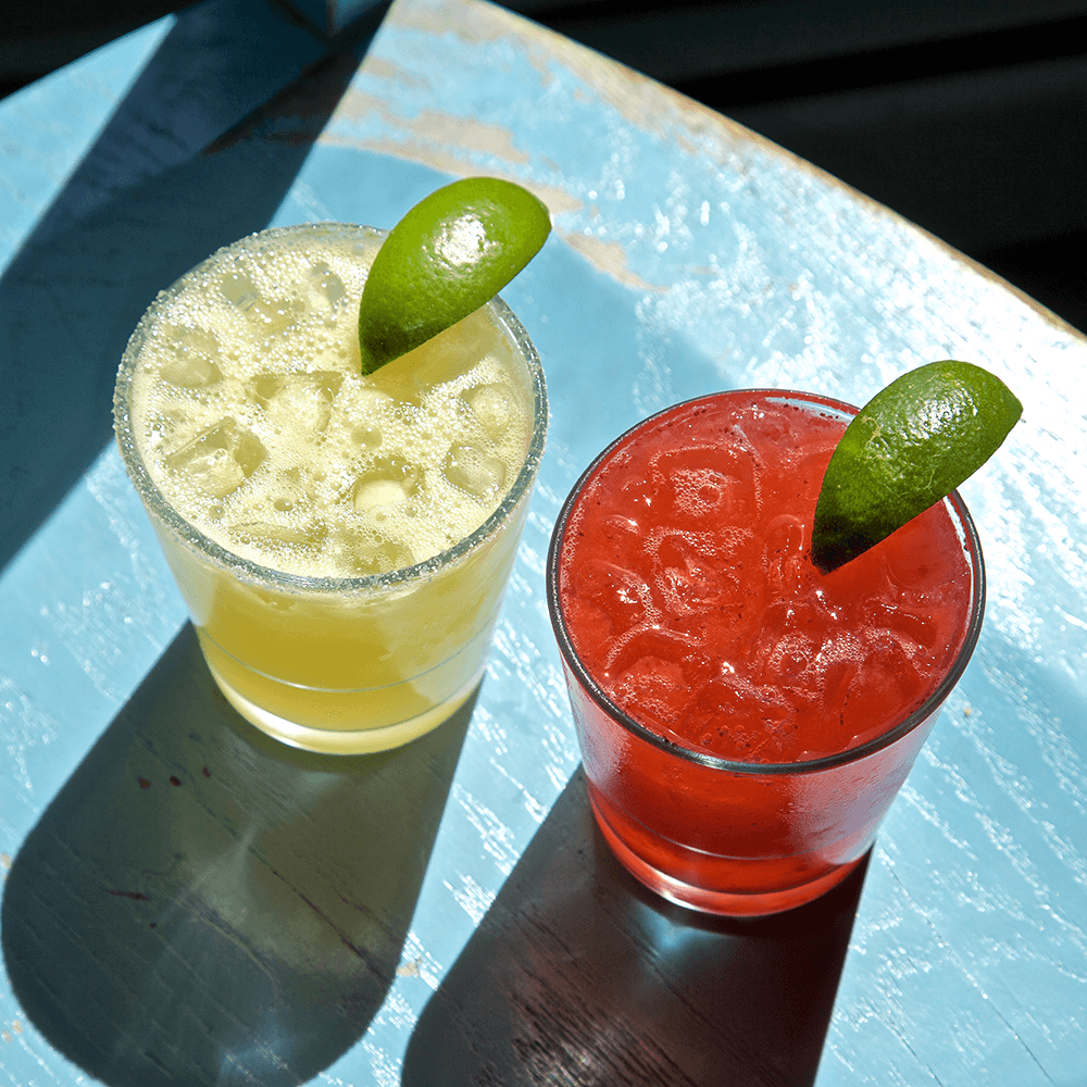 Two margarita drinks with lime